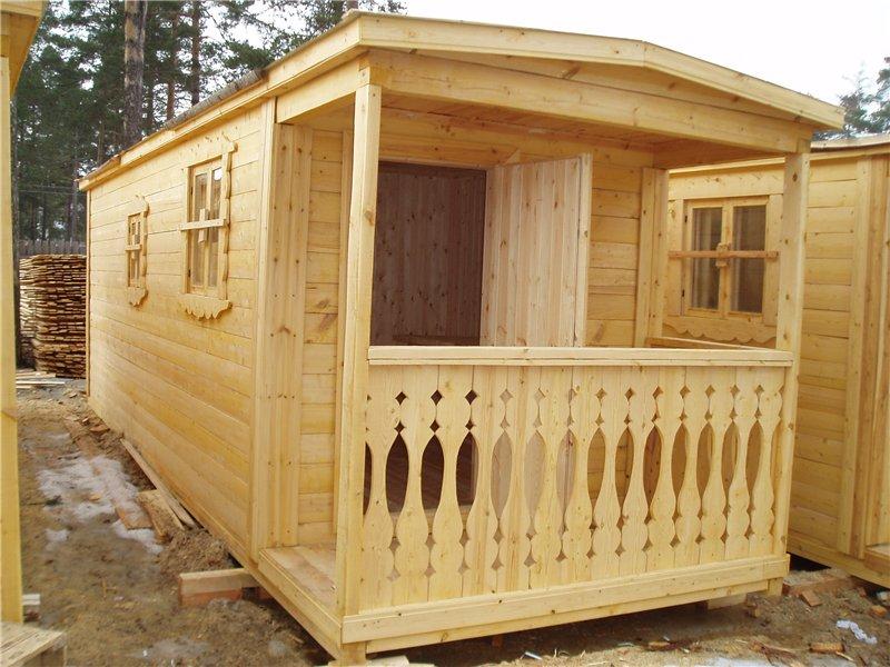 На фото – деревянный вагончик-