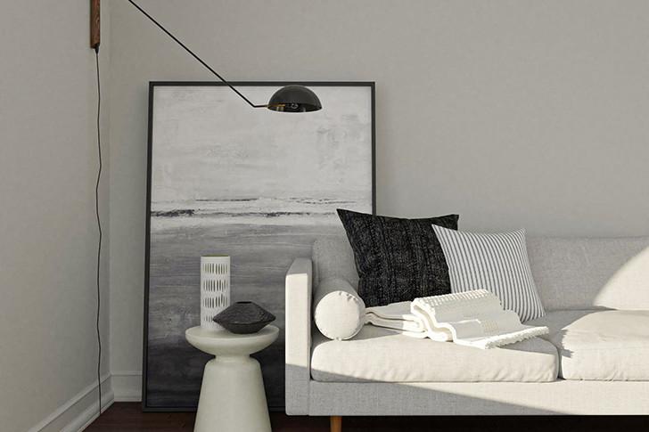 Гостиная в серых теплых тонах с более светлыми и более темными деталями, легкая для глаз и приятно укутывающая