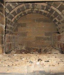 Чиста топливника в банной печи