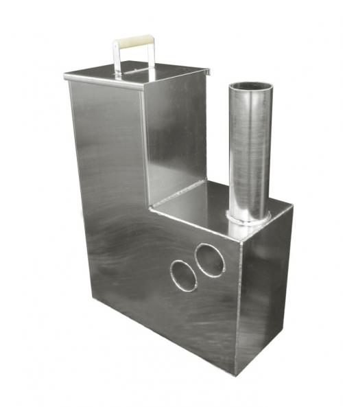 На фото – дровяная печь для офуро (помещается внутрь бочки)