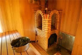 Печь в бане, обложенная кирпичом