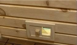 Внизу стены за печкой делают вентиляционное отверстие с дверцей или заглушкой.